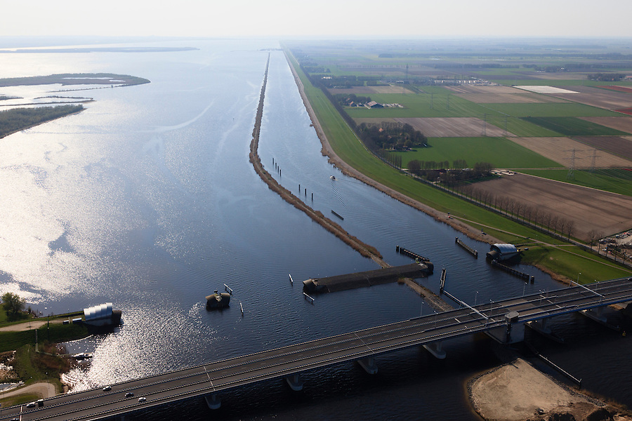 Nederland, Flevoland-Overijssel, Ramspol, 01-05-2013; Balgstuw met srekdam, rechts de vaargeul het Ramsdiep, links van de strekdam het Ketelmeer.<br /> Ramspol, inflatable dike, between Ketelmeer and Black Water. The Balgstuw (bellow barrier) is a storm barrier and consists of an inflatable dam or dyke, composed of three bellows. Usually, each bellow rests on the bottom of the water, but now the bellows are inflated  because of maintenance.<br /> luchtfoto (toeslag op standard tarieven)<br /> aerial photo (additional fee required)<br /> copyright foto/photo Siebe Swart