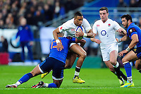 Anthony Watson of England takes on the France defence. RBS Six Nations match between France and England on March 19, 2016 at the Stade de France in Paris, France. Photo by: Patrick Khachfe / Onside Images