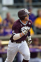 Texas A&M Aggies infielder Logan Taylor (17) runs to first base during the Southeastern Conference baseball game against the LSU Tigers on April 25, 2015 at Alex Box Stadium in Baton Rouge, Louisiana. Texas A&M defeated LSU 6-2. (Andrew Woolley/Four Seam Images)