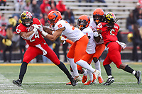 College Park, MD - October 27, 2018: Maryland Terrapins running back Ty Johnson (24) gets pushed out of bounds by Illinois Fighting Illini defensive back Sydney Brown (30) during the game between Illinois and Maryland at  Capital One Field at Maryland Stadium in College Park, MD.  (Photo by Elliott Brown/Media Images International)