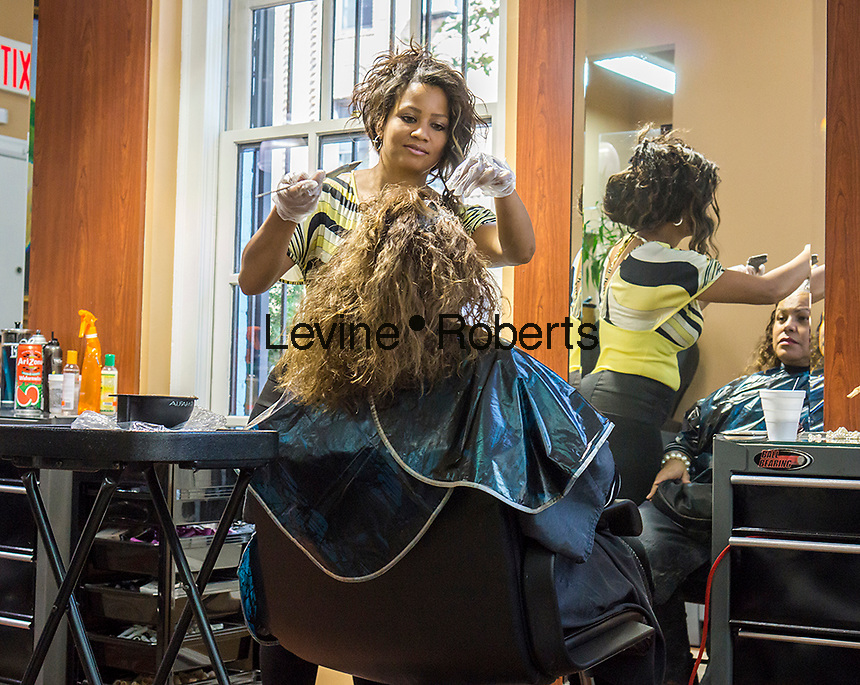 Customer has hair coloring in an Hispanic owned beauty salon in the Jackson Heights neighborhood of Queens in New York on Friday, September 27, 2013.  Jackson Heights is a polyglot of ethnic groups ranging from Bangladeshis to South American to Indian to everyone else. (© Richard B. Levine)