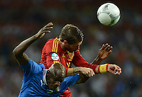 01.07.2012 Kiev, Ukraine.  Spain's Sergio Ramos (top) and Italy's Mario Balotelli challenge for the ball during the UEFA EURO 2012 final soccer match Spain vs. Italy at the Olympic Stadium in Kiev, Ukraine, 01 July 2012.