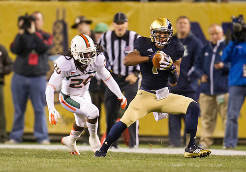 October 06, 2012:  Notre Dame wide receiver TJ Jones (7) catches pass as Miami defensive back Thomas Finnie (20) defends during NCAA Football game action between the Notre Dame Fighting Irish and the Miami Hurricanes at Soldier Field in Chicago, Illinois.  Notre Dame defeated Miami 41-3.