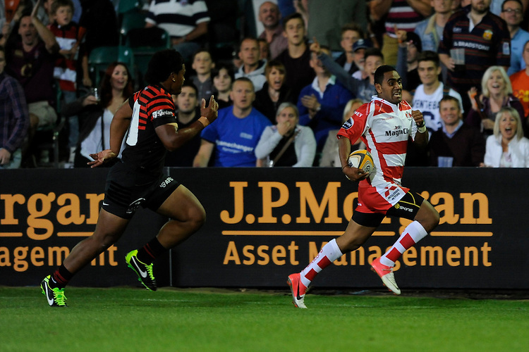 20130809 Copyright onEdition 2013 ©<br /> Free for editorial use image, please credit: onEdition.<br /> <br /> Andrew Bulumakau of Gloucester Rugby 7s scores the winning try to put his team into the final during the finals of the J.P. Morgan Asset Management Premiership Rugby 7s Series.<br /> <br /> The J.P. Morgan Asset Management Premiership Rugby 7s Series kicked off for the fourth season on Thursday 1st August with Pool A at Kingsholm, Gloucester with Pool B being played at Franklin's Gardens, Northampton on Friday 2nd August, Pool C at Allianz Park, Saracens home ground, on Saturday 3rd August and the Final being played at The Recreation Ground, Bath on Friday 9th August. The innovative tournament, which involves all 12 Premiership Rugby clubs, offers a fantastic platform for some of the country's finest young athletes to be exposed to the excitement, pressures and skills required to compete at an elite level.<br /> <br /> The 12 Premiership Rugby clubs are divided into three groups for the tournament, with the winner and runner up of each regional event going through to the Final. There are six games each evening, with each match consisting of two 7 minute halves with a 2 minute break at half time.<br /> <br /> For additional images please go to: http://www.w-w-i.com/jp_morgan_premiership_sevens/<br /> <br /> For press contacts contact: Beth Begg at brandRapport on D: +44 (0)20 7932 5813 M: +44 (0)7900 88231 E: BBegg@brand-rapport.com<br /> <br /> If you require a higher resolution image or you have any other onEdition photographic enquiries, please contact onEdition on 0845 900 2 900 or email info@onEdition.com<br /> This image is copyright the onEdition 2013©.<br /> <br /> This image has been supplied by onEdition and must be credited onEdition. The author is asserting his full Moral rights in relation to the publication of this image. Rights for onward transmission of any image or file is not granted or implied. Changing or deleting Copyright information is