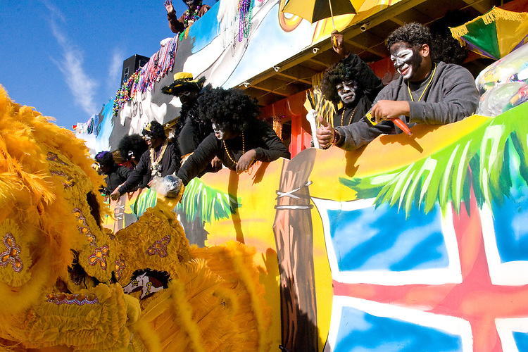 The Krewe of Zulu watches the Golden Comanches Mardi Gras Indians parade on the interstate to the Superdome in New Orleans on February 28, 2006.