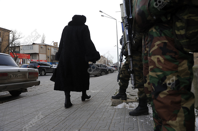 In the Dagestan capital Mahachkala, a woman walked past two special forces policemen standing guard on the street. January 27, 2010