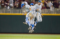 UCLA outfielders Christoph Bono (3), Brian Carroll (24) and Eric Filia (4) celebrate following their victory over the Mississippi State Bulldogs in Game 1 of the 2013 Men's College World Series Final on June 24, 2013 at TD Ameritrade Park in Omaha, Nebraska. The Bruins defeated the Bulldogs 2-1, taking a 1-0 lead in the best of 3 series. (Andrew Woolley/Four Seam Images)