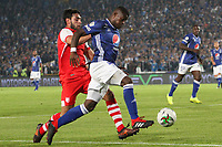 BOGOTÁ - COLOMBIA, 28-03-2019:Andres Roman (Der.) jugador de Millonarios disputa el balón con Nicolas Gil (Izq.) jugador del Independiente Santa Fe durante partido por la fecha 10 de la Liga Águila I 2019 jugado en el estadio Nemesio Camacho El Campín de la ciudad de Bogotá. /Andres Roman (R) player of Millonarios  fights for the ball with Nicolas Gil(L) player of Independiente Santa Fe  during the match for the date 10 of the Liga Aguila I 2019 played at the Nemesio Camacho El Campin Stadium in Bogota city. Photo: VizzorImage / Felipe Caicedo / Staff.