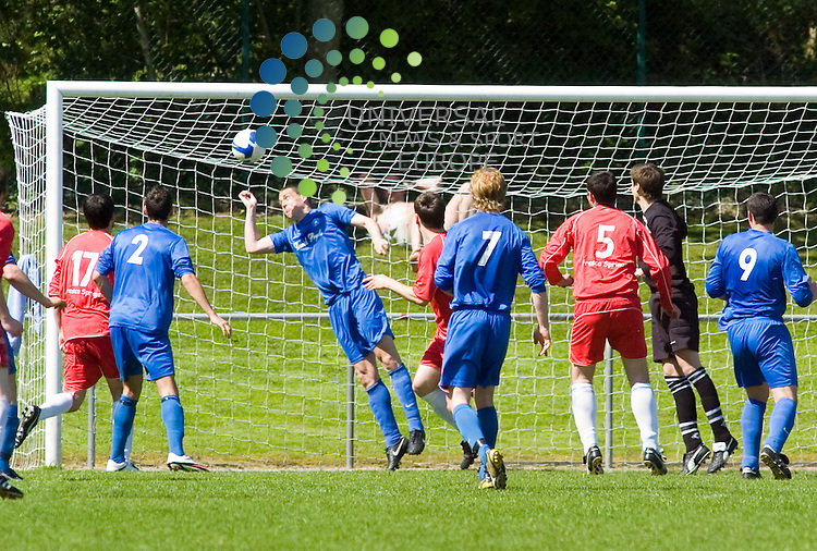 Lochee's Gary Middleton(centre of pic) scores with a header, East Region Super League game, pictures by Colin LunnPicture 22 May Universal News and Sport (Europe)<br /> All pictures must be credited to  www.universalnewsandsport.com. (0ffice) 0844 884 51 22.