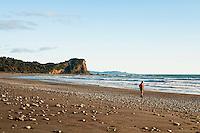 A woman hiking on Waiho Beach near Franz Josef Glacier township - Westland National Park, West Coast, New Zealand