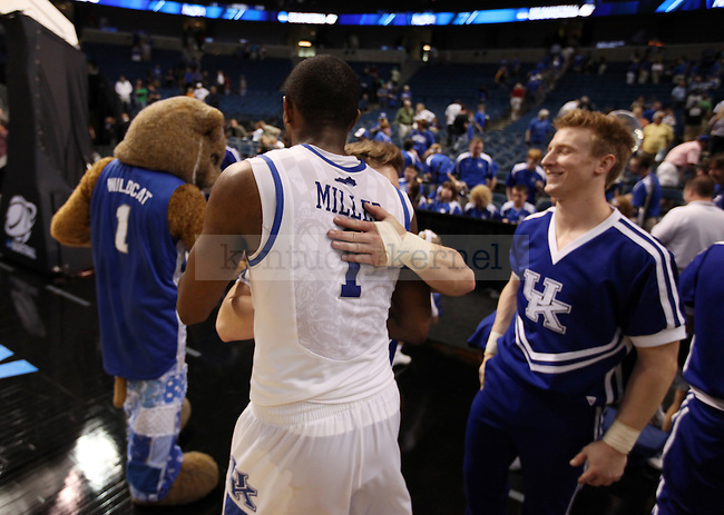 Darius Miller hugs a cheerleader after UK's first round NCAA tournament win against Princeton at the St. Pete Times Forum in Tampa, Florida on Thursday, March 17, 2011.  Photo by Britney McIntosh | Staff