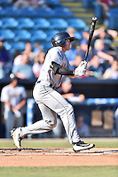 Charleston RiverDogs designated hitter Kyle Holder (4) swings at a pitch during a game against the Asheville Tourists at McCormick Field on July 9, 2016 in Asheville, North Carolina. The RiverDogs defeated the Tourists 10-9. (Tony Farlow/Four Seam Images)