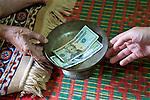 Presenting Donation, Wat Bo