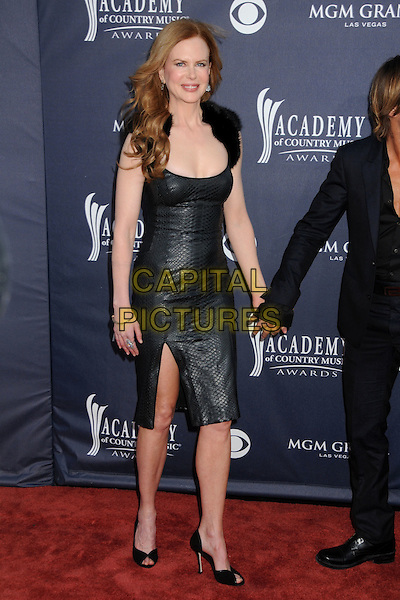 NICOLE KIDMAN.46th Annual Academy of Country Music Awards - Arrivals held at the MGM Grand Garden Arena, Las Vegas, Nevada, USA..April 3rd, 2011.full length dress slit split holding hands  black leather fur cleavage .CAP/ADM/BP.©Byron Purvis/AdMedia/Capital Pictures.