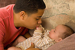 3 month old baby boy inteaction with 15 year old teenage half brother imitating his brother's sounds with bubbling horizontal Hispanic Puerto Rican