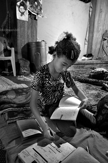 2010 October 17 - Gaza - Zeitoun<br /> Amal Samouni making her homework for school. During operation 'Cast Lead', she lost her father and 4-year old brother Ahmed. Amal got injured by shrapnel in her head when the house, where she and 100 family members were forced in by the Israeli soldiers, got bombed. She remained under the rubble of the house of 3 days, as the ambulances where not allowed to enter the area.
