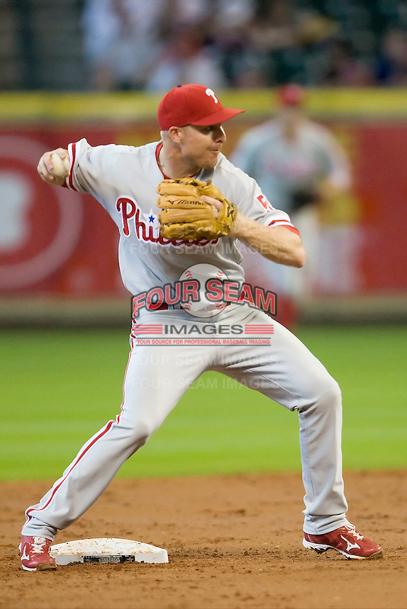 Philadelphia Phillies shortstop Pete Orr #5 turns a double play during second inning of the Major League Baseball game against the Houston Astros at Minute Maid Park in Houston, Texas on September 14, 2011. Philadelphia defeated Houston 1-0 to clinch a playoff berth.  (Andrew Woolley/Four Seam Images)