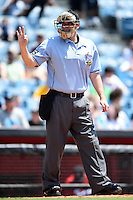 Home plate umpire Brandon Misun signals for three baseballs during a game between the Omaha Storm Chasers and Nashville Sounds on May 20, 2014 at Herschel Greer Stadium in Nashville, Tennessee.  Omaha defeated Nashville 4-1.  (Mike Janes/Four Seam Images)