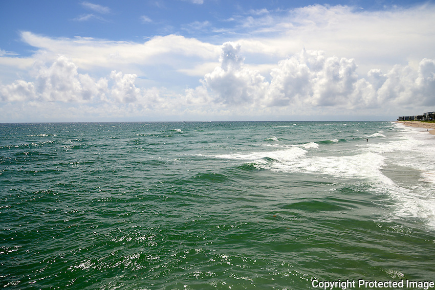 Late morning reveals a rough surf and beautiful cloud formation at  Lake Worth Beach, Lake Worth, Florida.