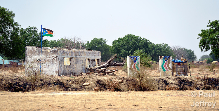 The flag of South Sudan flies over the ruins of a government office in Abyei, a town at the center of the contested Abyei region along the border between Sudan and South Sudan. Buildings here were looted and burned in 2011 when soldiers and militias from the northern Republic of Sudan swept through the area, chasing out more than 100,000 Dinka Ngok residents. A few thousand families have returned since northern combatants withdrew in 2012, yet their life is precarious. Although Ethiopian peacekeepers today patrol the region, renewed attacks by northern-backed Misseriya militias in 2013 have many worried. The African Union has proposed a new peace plan, including a referendum to be held in October 2013, but it has been rejected by the Misseriya and Khartoum.