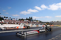 Aug. 4, 2013; Kent, WA, USA: NHRA top fuel dragster driver Tommy Johnson Jr (near lane) races alongside Clay Millican during the Northwest Nationals at Pacific Raceways. Mandatory Credit: Mark J. Rebilas-USA TODAY Sports