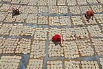 Workers drying noodles by Abdul Momin