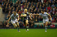 Matt Hopper of Harlequins accelerates past Jamie Gibson (left) and Steven Shingler of London Irish during the Aviva Premiership match between Harlequins and London Irish at Twickenham on Saturday 29th December 2012 (Photo by Rob Munro).