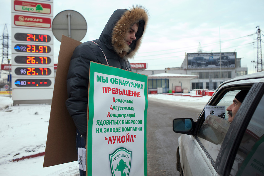 Moscow, Russia, 12/12//2010..Ecological activists mark Russian Constitution Day by picketing some 300 Moscow petrol stations, leafletting drivers and accusing the companies of pollution and demanding the constitutional right to a clean environment.
