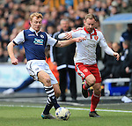 Millwall's Chris Taylor tussles with Sheffield United's Matt Done during the League One match at The Den.  Photo credit should read: David Klein/Sportimage