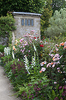 Sunlit summer border at Haddon Hall