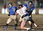 Bishop Gorman's McKay Wilson (81) battles Reed lineman Stein Otuafi (68) to sack Reed quarterback Matt Denn (15) in an NIAA Division I playoff game at Reed High School in Sparks, Nev., on Saturday, Nov. 28, 2015. Bishop Gorman won 41-13. (Cathleen Allison/Las Vegas Review-Journal)