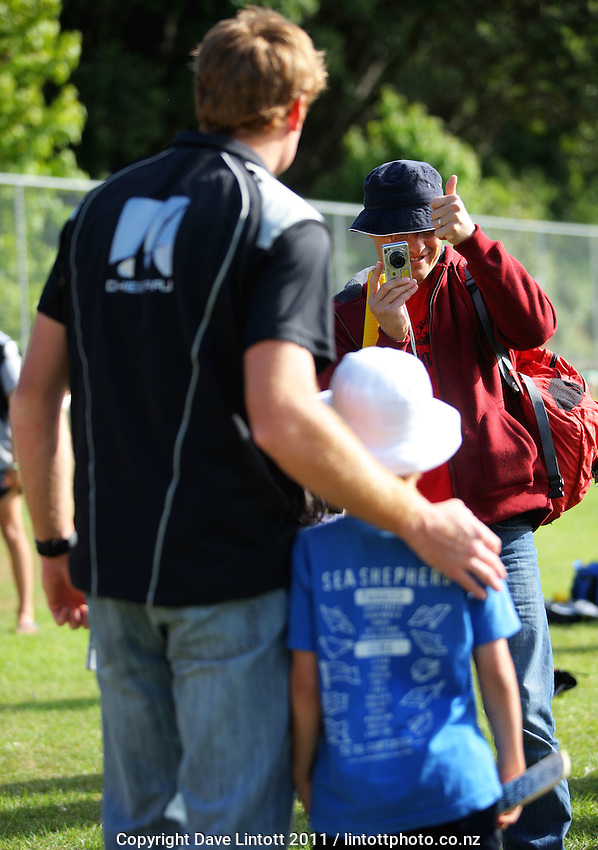 Martin Guptill poses for a photo with a young fan. NCC cricket supercamp at Anderson Park, Wellington, New Zealand on Thursday, 13 January 2011. Photo: Dave Lintott / lintottphoto.co.nz