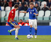 Italy Ciro Immobile, right, is challenged by Spain Gerard Pique&rsquo; during the Fifa World Cup 2018 qualification soccer match between Italy and Spain at Turin's Juventus Stadium, October 6, 2016. The game ended 1-1.<br /> UPDATE IMAGES PRESS/Isabella Bonotto