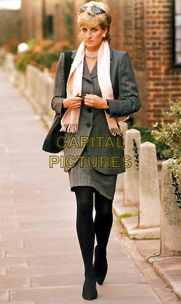 DIANA, PRINCESS OF WALES.Ref: 1607.paparazzi, scarf, walking, grey, gray pinstripe suit, full length, full-length.www.capitalpictures.com.sales@capitalpictures.com.©Capital Pictures