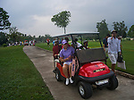 CHON BURI, THAILAND - FEBRUARY 17:  Players leave the course and head for cover as heavy skies bring lightning and rain during day two of the LPGA Thailand at Siam Country Club on February 17, 2012 in Chon Buri, Thailand.  Photo by Victor Fraile / The Power of Sport Images