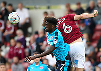 Fleetwood Town's Jordy Hiwula competing with Northampton Town's Ash Taylor<br /> <br /> Photographer Andrew Kearns/CameraSport<br /> <br /> The EFL Sky Bet League One - Northampton Town v Fleetwood Town - Saturday August 12th 2017 - Sixfields Stadium - Northampton<br /> <br /> World Copyright &copy; 2017 CameraSport. All rights reserved. 43 Linden Ave. Countesthorpe. Leicester. England. LE8 5PG - Tel: +44 (0) 116 277 4147 - admin@camerasport.com - www.camerasport.com
