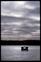 A LONE ICE FISHING SHANTY IS SEEN ON FROZEN SILVER LAKE IN LAONA WISCONSIN UNDER AN OVERCAST SKY