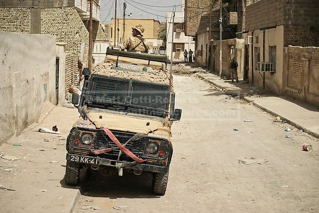 28/11/2012. FILE PICTURE 28/11/2012. A British army 'Snatch' Land Rover is seen during operations in Basra City, Iraq in June 2005. Relatives of soldiers who were killed and injured using equipment, such as the Snatch Land Rover, have recently (19/10/12) received a judgment in the Court of Appeal stating that the Ministry of Defence - like any other employer - owed its soldiers a duty of care which extended to equipment on operations. Photo credit: Matt Cetti-Roberts