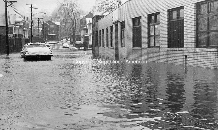 Heavy rain and snow triggered widespread flooding in Waterbury, closing streets, hitting business establishments and private homes in March of 1980. Here, Division Street looks more like Lake Quassapaug.