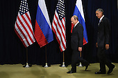 President Vladimir Putin of Russia (L) and U.S. President Barack Obama walk out for a photo-op before the start of a bilateral meeting at the United Nations headquarters September 28, 2015 in New York City. Putin and Obama are in New York City to attend the 70th anniversary general assembly meetings. <br /> Credit: Chip Somodevilla / Pool via CNP