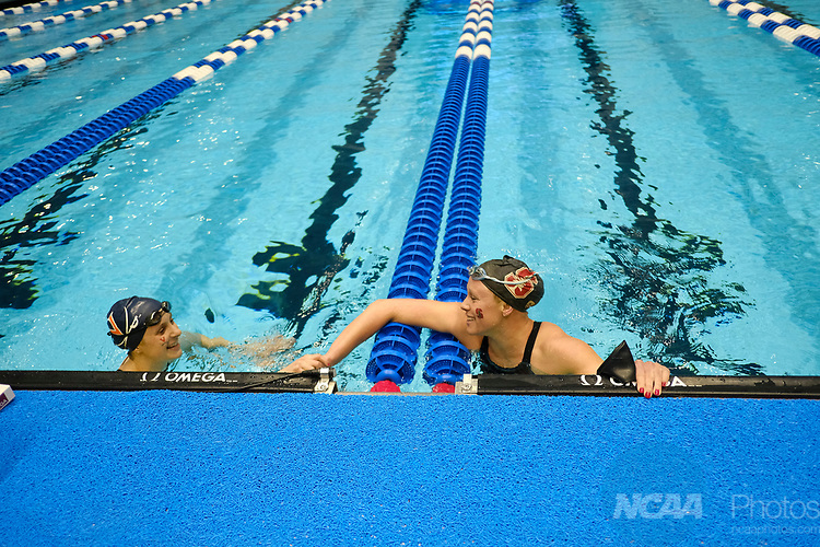 INDIANAPOLIS, IN - MARCH 18: Ella Eastein, of Stanford, shakes hands with Kaitlyn Jones of the University of Virginia after swimming in the 200 Yard Butterfly during the Division I Women's Swimming & Diving Championships held at the Indiana University Natatorium on March 18, 2017 in Indianapolis, Indiana. (Photo by A.J. Mast/NCAA Photos via Getty Images)