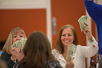 A flash of single dollars signal a willingness to buy a tciket to neter the next round at a meat raffle at the  Moose Lodge in Lancaster, NY. Meat raffles have become poular fundraisers in Western New York. April 17, 2016