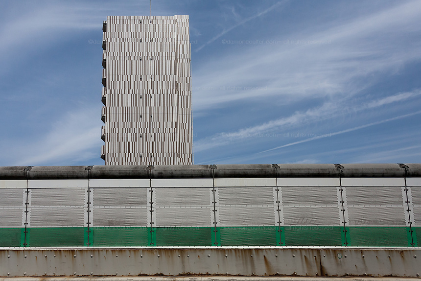 An apartment building towers over the sound-proofing walls on an expressway overpass in Tokyo, Japan. Sunday May 5th 2019
