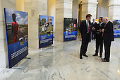 Prince Harry of Wales (L) tours a HALO Trust photo exhibit on landmines and unexploded ordinances, with Republican Senator from Arizona John McCain (R) and Halo Trust Director Guy Willoughby (2-R), on Capitol Hill in Washington DC, USA, 09 May 2013. Prince Harry begins a six-day tour of the United States..Credit: Michael Reynolds / Pool via CNP