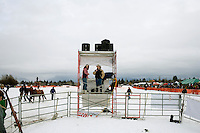 Anouncers work from a booth overlooking the competition area at the Whitefish Skijoring World Championship event in Whitefish, Montana, USA.  Skijoring is a competitive sport in which a person on skis navigates an obstacle course while being pulled behind a galloping horse.