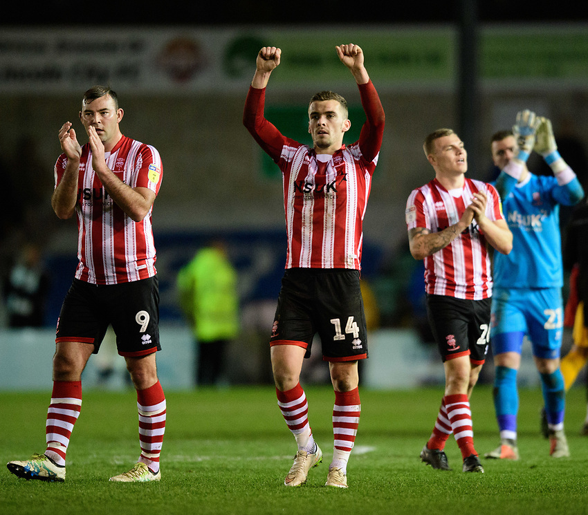Lincoln City's Matt Rhead, left, with team-mate Harry Toffolo applaud the fans at the final whistle<br /> <br /> Photographer Chris Vaughan/CameraSport<br /> <br /> The EFL Sky Bet League Two - Lincoln City v Newport County - Saturday 22nd December 201 - Sincil Bank - Lincoln<br /> <br /> World Copyright © 2018 CameraSport. All rights reserved. 43 Linden Ave. Countesthorpe. Leicester. England. LE8 5PG - Tel: +44 (0) 116 277 4147 - admin@camerasport.com - www.camerasport.com
