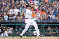 Miguel Cabrera (24) of the Detroit Tigers follows through on his swing against the Chicago White Sox at Comerica Park on June 2, 2017 in Detroit, Michigan.  The Tigers defeated the White Sox 15-5.  (Brian Westerholt/Four Seam Images)
