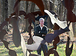 David M. Hayes son of the late David Hayes at the Hayes Farmstead stands among he Sculptures created by his father the late David Hayes, the fields of sculptures  have been listed on the State Register of Historic Places, Wednesday, November 15, 2017, in Coventry. (Jim Michaud / Journal Inquirer)