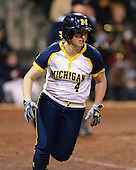 Michigan Wolverines Softball infielder Taylor Hasselbach (4) runs to first during a game against the University of South Florida Bulls on February 8, 2014 at the USF Softball Stadium in Tampa, Florida.  Michigan defeated USF 3-2.  (Copyright Mike Janes Photography)