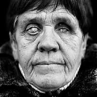 "Elena Griczienko (German, born in USSR, 1939), blinded during the Second World War (WWII). ""I was too small to remember the train journey. I only know it through my mother. The German army in the Ukraine approached the Donbas region where we lived and because we were ethnic Germans, the Soviets relocated us to Kazakhstan. We had one night to pack our things. My father was killed in the Finnish-Russian war in 1939 so I went with my mother. The journey lasted two months. We were put in a railway carriage together with cattle. There was almost nothing to eat and I was sick. It was December. I got frostbite, first on my legs and then in the eyes. In the spring I became blind. Once in Kazakhstan, my mother had to look after cattle in the kolkhoz in Sewjerni. We Germans were not allowed to leave our village until 1955. After that I could attend a school for the blind in the city. Like all the other blind girls, I became a seamstress. I made mattresses. I met my husband in the music school. The upbringing of our three children was difficult but I have done it well. Do you know what I would like? To be able to see my children for a minute or even a second."".. CHECK with MRM/FNA"